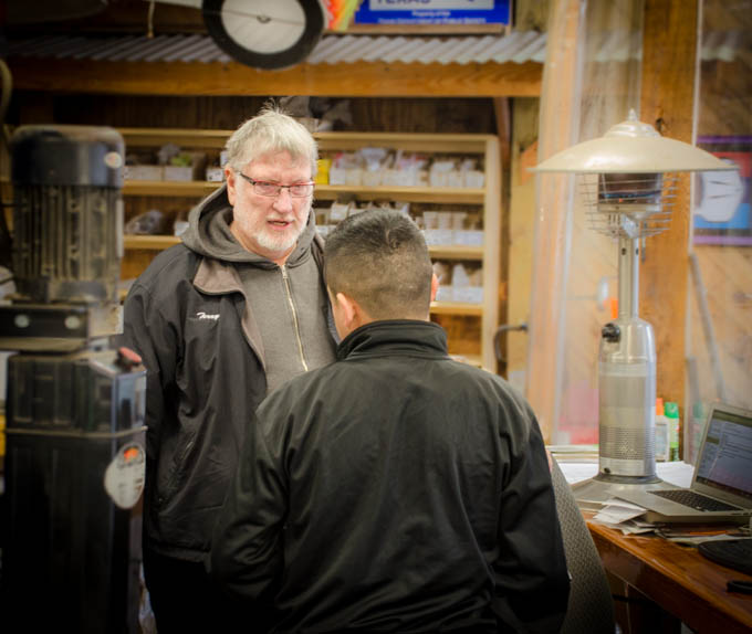 Owner Terry Sayther speaks with a customer