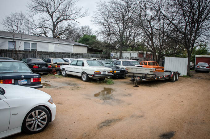 A nearby compound stores a number of Terry's car collection.